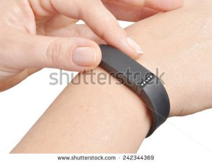 stock-photo-activity-tracker-on-a-woman-s-wrist-242344369 fitbit
