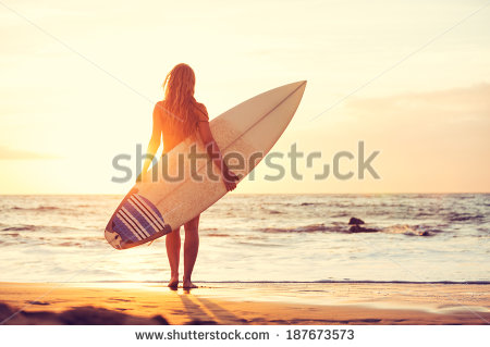 stock-photo-beautiful-sexy-surfer-girl-on-the-beach-at-sunset-187673573