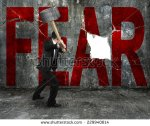 stock-photo-businessman-holding-sledgehammer-hitting-red-fear-word-on-concrete-wall-with-large-blank-hole-229940614