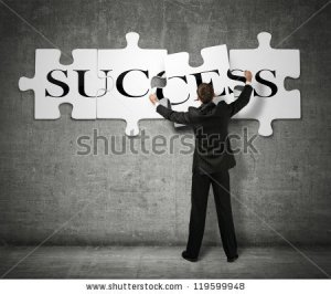 stock-photo-businessman-making-a-puzzle-on-the-wall-with-the-word-success-119599948