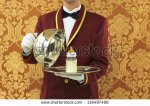 stock-photo-butler-with-silver-tray-and-bottle-of-milk-116497486 gosse de riche