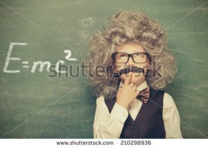 stock-photo--cheerful-smiling-little-kid-boy-against-chalkboard-looking-at-camera-little-einstein-style-210298936