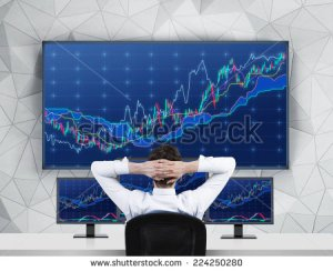 stock-photo-chilling-trader-in-front-of-forex-screens-224250280