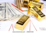 stock-photo-gold-bullion-with-money-on-table-close-up-296587400 or