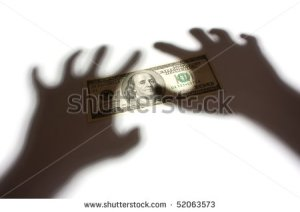 stock-photo-hand-shadow-over-money-concept-52063573