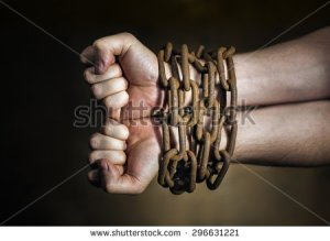 stock-photo-hands-of-a-man-with-a-rusty-chain-around-the-wrists-296631221 slave blood