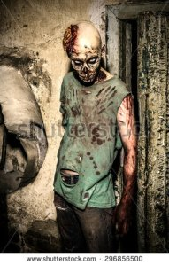 stock-photo-horrible-scary-zombie-man-on-the-ruins-of-an-old-house-horror-halloween-296856500 zombie