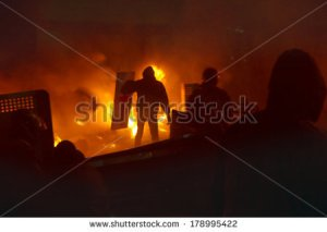 stock-photo-kiev-ukraine-january-among-the-flame-burning-wheels-rebel-fighters-try-to-contain-the-178995422 émeute