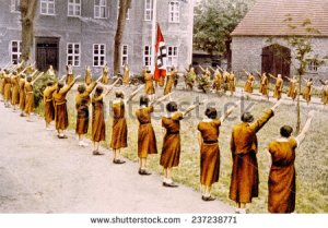 stock-photo-nazi-germany-junge-deutsche-madel-giving-the-nazi-salute-c-237238771 nazis