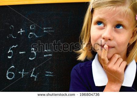 stock-photo-school-girl-doing-math-problems-on-the-chalkboard-196804736