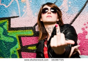 stock-photo-stylish-fashionable-girl-showing-fuck-off-middle-finger-gesture-against-colorful-graffiti-wall-161967725