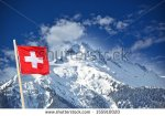 stock-photo-swiss-flag-on-the-top-of-the-mountain-in-switzerland-155910020 suisse