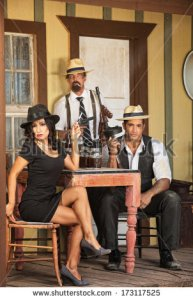 stock-photo-three-criminal-gangsters-with-weapons-and-whiskey-173117525 mexique gangster criminel