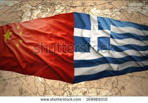 stock-photo-waving-greek-and-chinese-flags-on-the-background-of-the-political-map-of-the-world-169969310 chine grèce