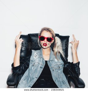 stock-photo-young-blonde-woman-in-sunglasses-sit-on-black-office-chair-and-showing-middle-finger-fashion-238349521 (2) fuck
