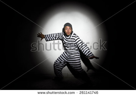 stock-photo-a-prisoner-trying-to-escape-from-prison-being-caught-by-a-search-light-261141746