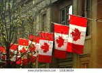 stock-photo-a-row-of-canadian-flags-outside-canada-house-in-trafalgar-square-london-131636654