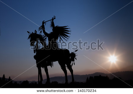 stock-photo-a-silhouette-of-a-native-american-on-a-horse-made-from-metal-with-eight-rays-emanating-out-from-the-140170234