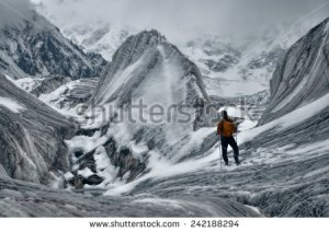 stock-photo-adventurous-hiker-on-engilchek-glacier-in-scenic-tian-shan-mountain-range-in-kyrgyzstan-242188294