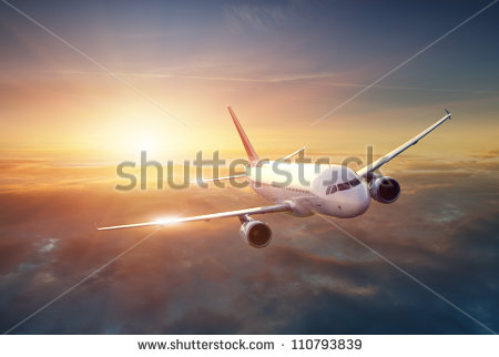 stock-photo-airplane-in-the-sky-at-sunset-110793839