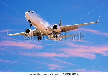 stock-photo-boeing-landing-from-bright-twilight-sky-129374012