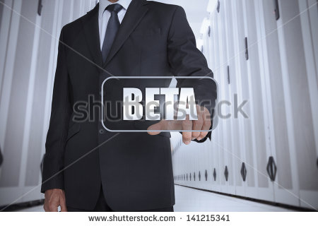 stock-photo-businessman-in-a-data-center-selecting-label-with-beta-written-on-it-141215341