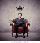 stock-photo-businessman-sitting-on-an-armchair-with-a-crown-over-his-head-83564674