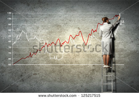 stock-photo-businesswoman-standing-on-ladder-drawing-diagrams-and-graphs-on-wall-125217515