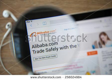 stock-photo-chiangmai-thailand-february-alibaba-homepage-on-a-ipad-monitor-screen-through-a-magnifying-256024984