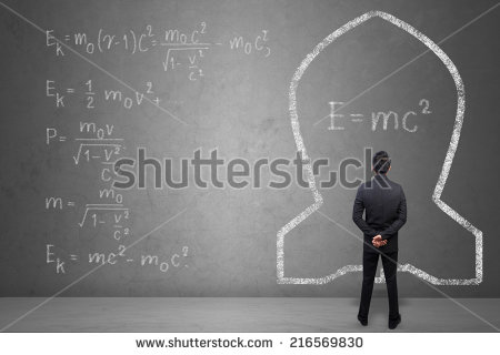 stock-photo-concept-of-a-businessman-that-solves-problems-of-albert-einsteins-physical-formula-on-concrete-wall-216569830
