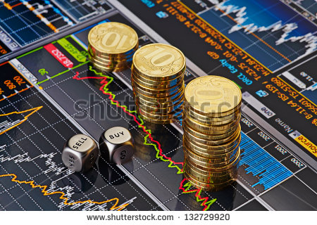 stock-photo-dices-cubes-with-the-words-sell-buy-uptrend-stacks-of-golden-coins-financial-chart-as-background-132729920