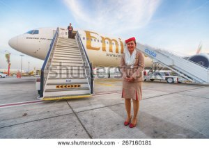 stock-photo-dubai-uae-march-emirates-crew-member-near-boeing-emirates-is-one-of-two-flag-267160181