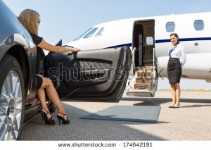 stock-photo-elegant-woman-stepping-out-of-car-parked-in-front-of-private-plane-and-airhostess-174642191