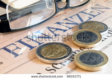 stock-photo-euro-coins-black-glasses-and-the-lettering-finances-in-german-language-96053771
