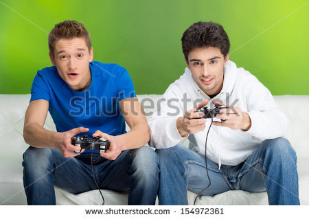 stock-photo-gamers-with-joystick-two-young-gamers-playing-video-games-while-sitting-on-the-couch-154972361