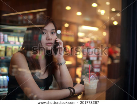 stock-photo-girl-on-call-in-cafe-when-someone-late-behind-window-view-from-window-201773297