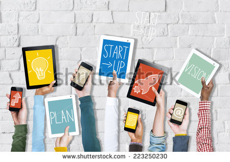 stock-photo-group-of-hands-holding-digital-devices-with-startup-concept-223250230