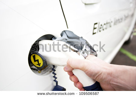 stock-photo-human-hand-is-holding-electric-car-charging-nozzle-selective-focus-on-hand-and-nozzle-109506587