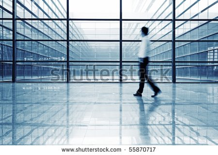 stock-photo-image-of-people-silhouettes-at-morden-office-building-55870717 finance