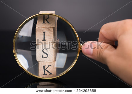 stock-photo-inspecting-risk-blocks-with-loupe-over-black-background-224295658 risque