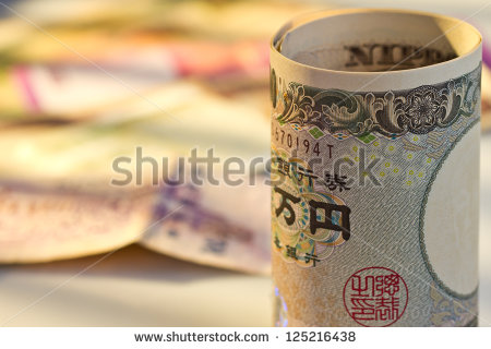 stock-photo-japan-yen-in-front-of-multi-national-bank-note-125216438