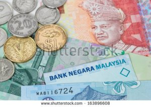 stock-photo-malaysian-money-ringgit-banknote-and-coins-close-up-163896608