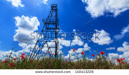 stock-photo-oil-and-gas-rig-profiled-on-blue-sky-with-clouds-140413228