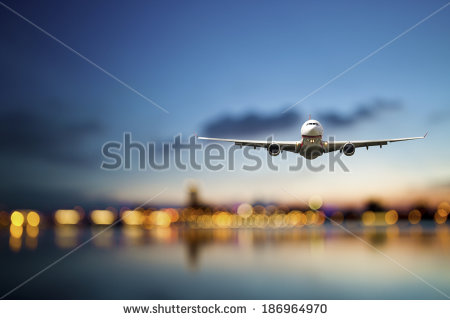 stock-photo-perspective-view-of-jet-airliner-in-flight-with-bokeh-background-186964970