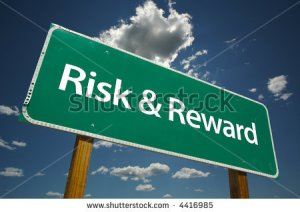 stock-photo--risk-reward-road-sign-with-dramatic-clouds-and-sky-4416985