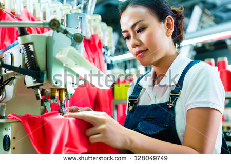stock-photo-seamstress-or-chinese-worker-in-a-factory-sewing-with-a-industrial-sewing-machine-she-is-very-128049749
