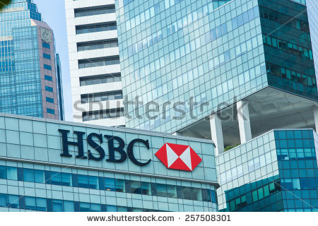 stock-photo-singapore-jan-logo-of-hsbc-on-top-of-building-and-business-building-background-257508301