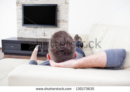 stock-photo-single-man-on-the-couch-watching-tv-changing-channels-130173635