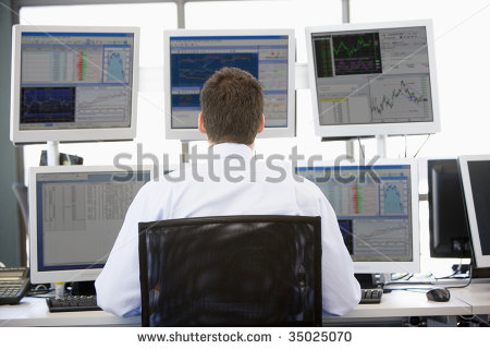 stock-photo-stock-trader-looking-at-multiple-monitors-35025070