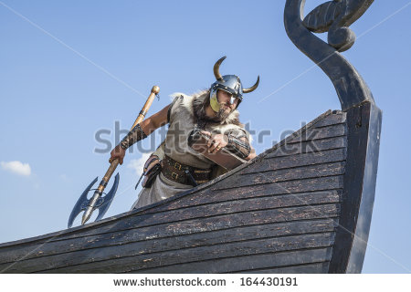 stock-photo-strong-viking-on-his-ship-looking-to-beach-164430191